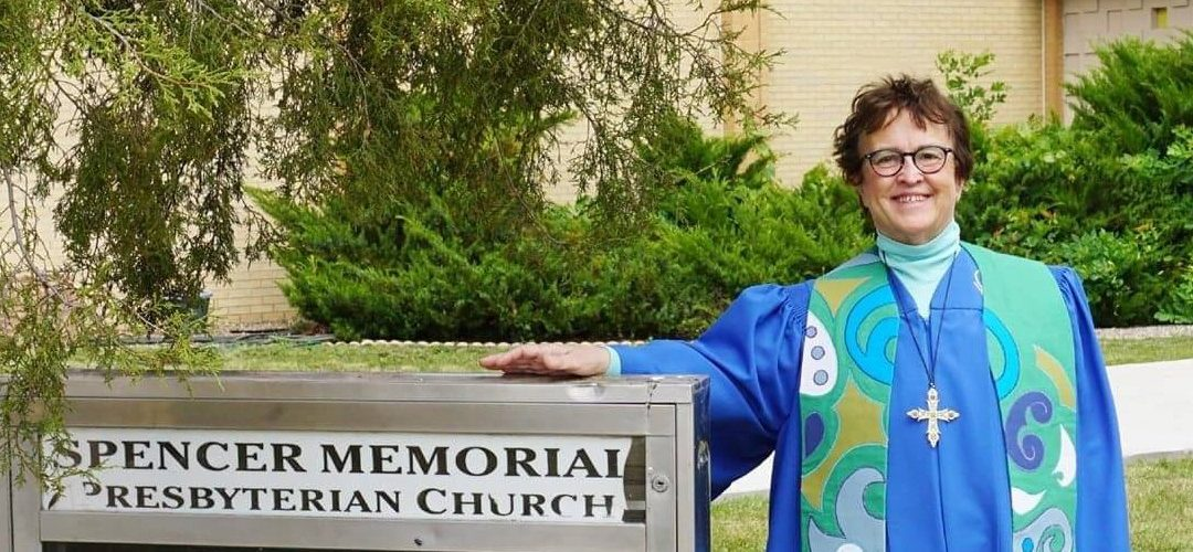 Pastor Barb in front of church